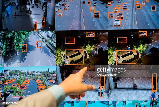 A display shows a vehicle and person recognition system for law enforcement during the NVIDIA GPU Technology Conference which showcases artificial...
