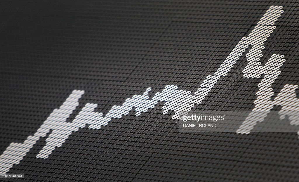A display shows the graph of the German stock market index DAX at the stock exchange in Frankfurt am Main, central German November 7, 2013. Germany's DAX stock index set a new all-time high of 9193 after the ECB cut its key interests rates, still has other weapons up its sleeve to boost recovery in the euro, Draghi said.