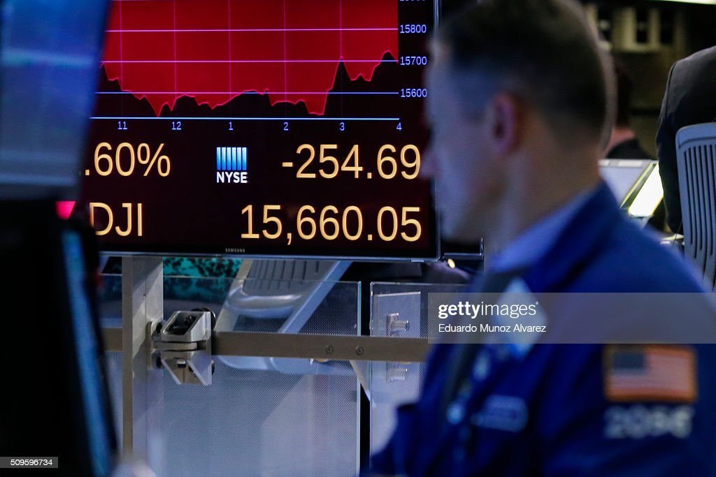 A display shows the results of Down Jones as a trader works on the floor of the New York Stock Exchange (NYSE) on February 11, 2016 in New York City. Stocks were down for the fifth day in a row, buffeted in part by falling oil prices.