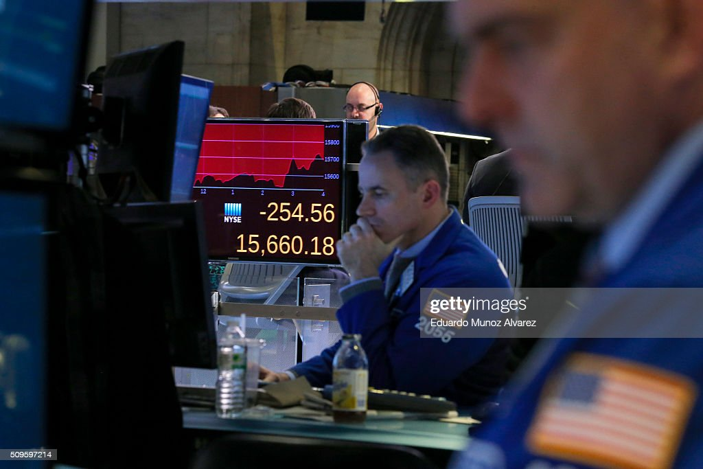 A display shows the results of Down Jones as traders work on the floor of the New York Stock Exchange (NYSE) on February 11, 2016 in New York City. Stocks were down for the fifth day in a row, buffeted in part by falling oil prices.