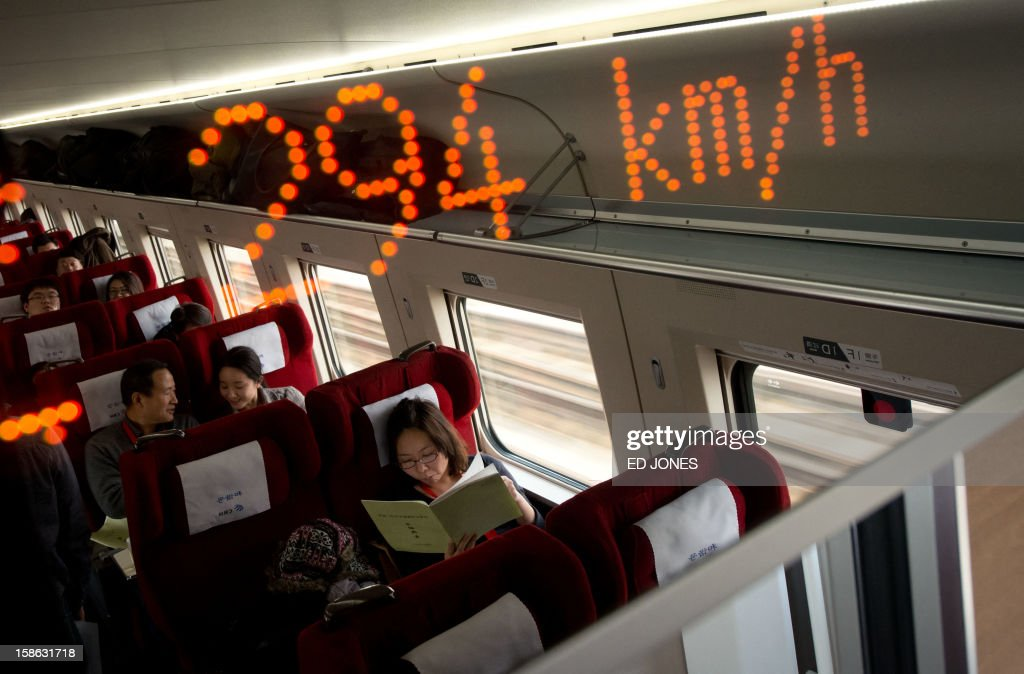 A display shows the speed aboard a high-speed train in Hebei province south of Beijing on December 22, 2012. China showed off the final link of the world's longest high-speed rail route, set to open on December 26, stretching from Beijing to the southern Chinese city of Guangzhou. Travelling at around 300 kph, trains on the new route are expected to cover the 2,298-kilometre (1,425-mile) journey in a third of the current time from 22 hours to eight. AFP PHOTO / Ed Jones