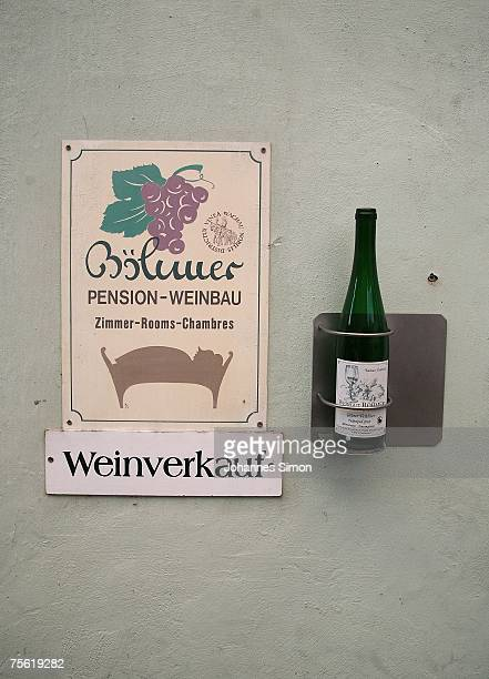 A displayed wine bottle indicates the house of a winemaker on July 24 2007 in Duernstein Austria Unusually strong insolation in eastern Austria has...