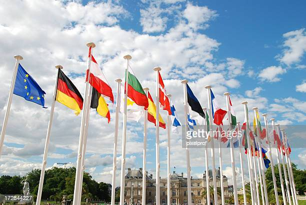 Displays of au country flags standing on white poles