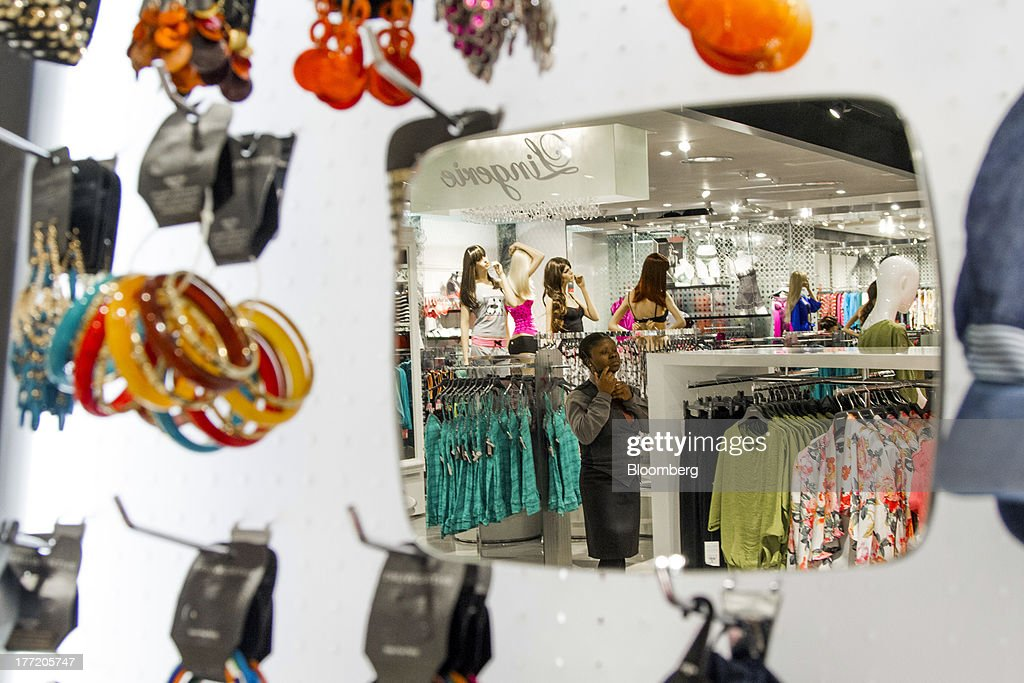 Displays of fashion clothing is reflected in a mirror inside a Truworths International Ltd. store, South Africa's largest listed clothing retailer, in the Sandton district of Johannesburg, South Africa, on Thursday, Aug. 22, 2013. Massmart Holdings Ltd., the South African food and goods wholesaler owned by Wal-Mart Stores Inc., said revenue growth continued to slow in August after a downturn in consumer spending hurt first-half earnings. Photographer: Nadine Hutton/Bloomberg via Getty Images