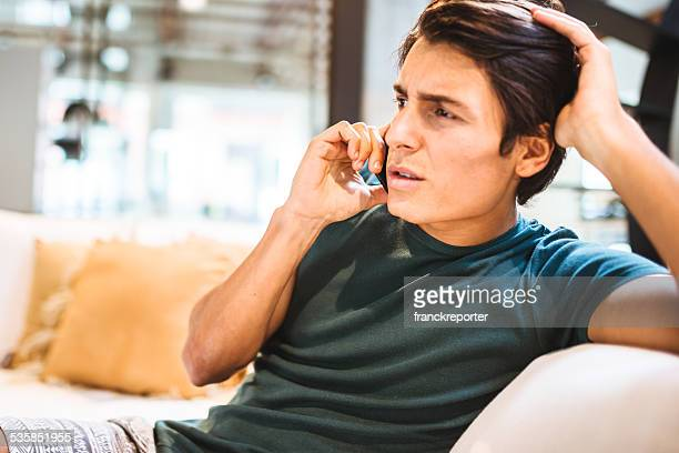 Displeased Man have a phone call at home