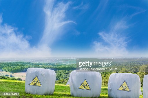 Disposable Containers On Landscape Against Sky