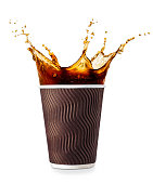 disposable corrugated paper cup isolated on white background. Coffee splash. Take away cup of coffee. Coffee to go