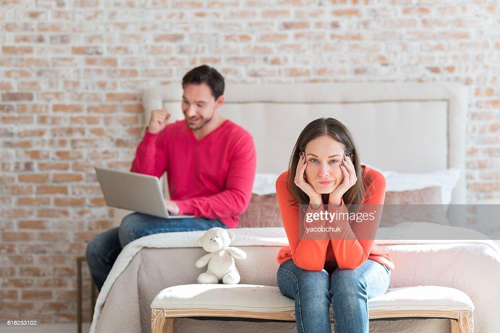 Dissatisfied unhappy woman sitting in the bedroom : Foto de stock
