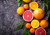 Dissected fresh fruits.  Orange, grapefruit and tangerines. Selective focus