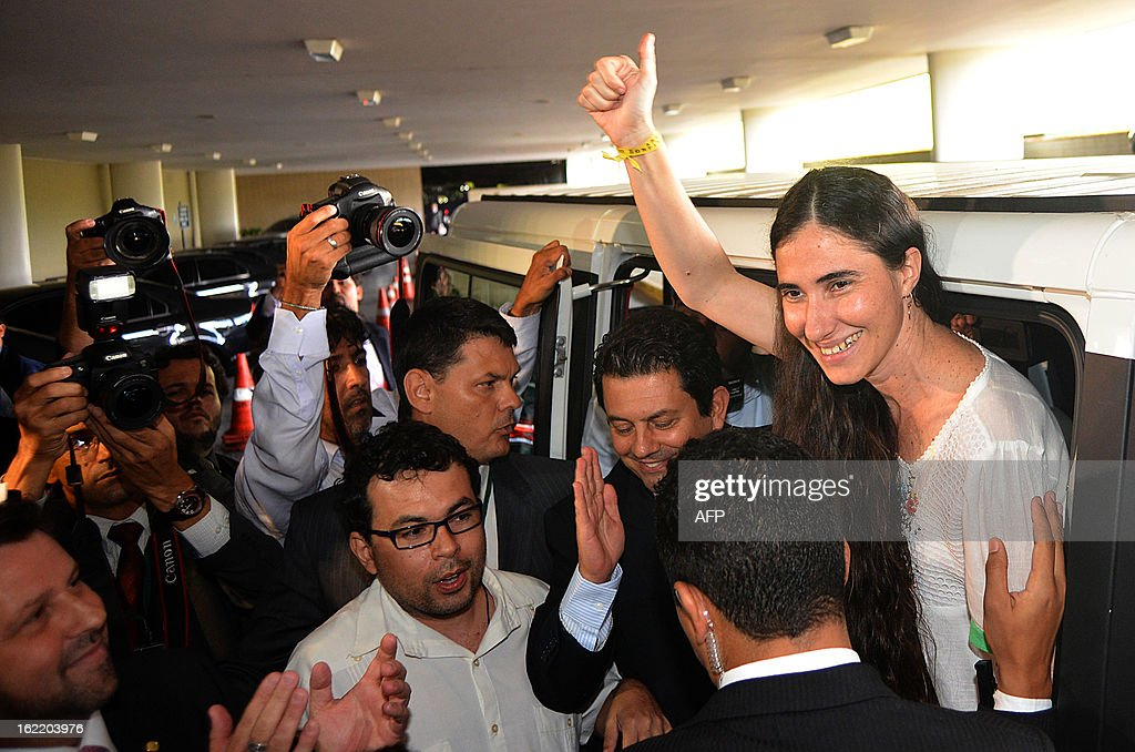 Dissident Cuban blogger Yoani Sanchez gives a thumb up upon her arrival at the National Congress, in Brasilia, on February 20, 2013. Sanchez is on an 80-day tour, after she got a passport two weeks ago under Cuba's sweeping immigration reform that went into effect this year. The 37-year-old philologist, who found an international audience on the Internet with her prize-winning blog 'Generation Y,' is known for her biting commentary, which has drawn the displeasure of Cuba's ruling communist party. AFP PHOTO/Pedro LADEIRA