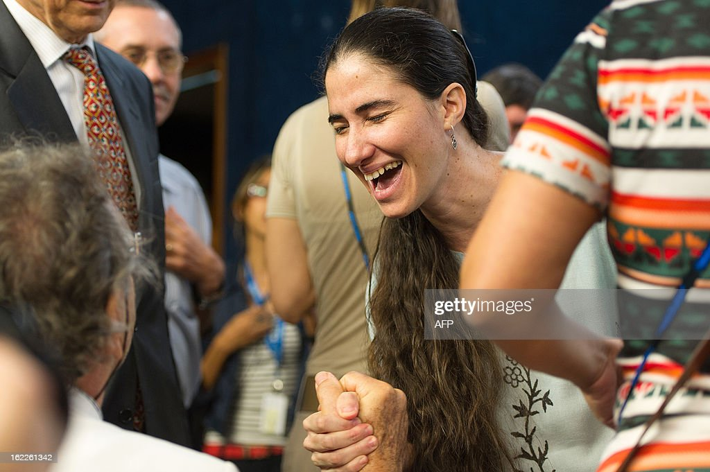 Dissident Cuban blogger Yoani Sanchez laughs after a debate in Sao Paulo, Brazil, on February 21, 2013. Sanchez is on an 80-day tour, after she got a passport two weeks ago under Cuba's sweeping immigration reform that went into effect this year. The 37-year-old philologist, who found an international audience on the Internet with her award-winning blog 'Generation Y,' is known for her biting commentary, which has drawn the displeasure of Cuba's ruling communist party. AFP PHOTO/Yasuyoshi CHIBA
