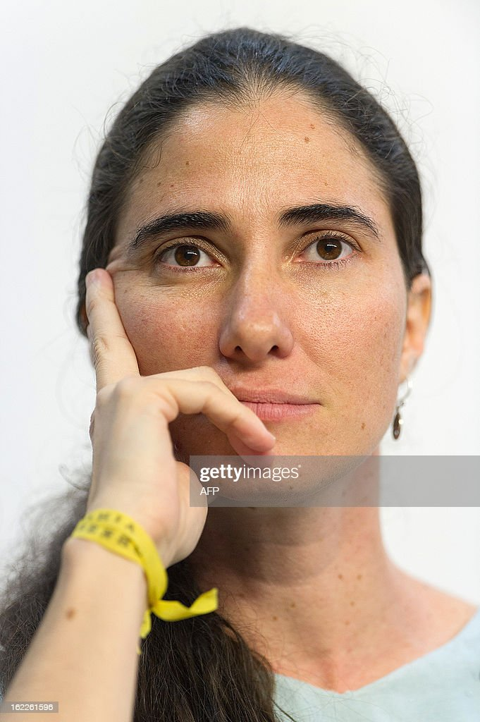 Dissident Cuban blogger Yoani Sanchez listens during a debate in Sao Paulo, Brazil, on February 21, 2013. Sanchez is on an 80-day tour, after she got a passport two weeks ago under Cuba's sweeping immigration reform that went into effect this year. The 37-year-old philologist, who found an international audience on the Internet with her award-winning blog 'Generation Y,' is known for her biting commentary, which has drawn the displeasure of Cuba's ruling communist party. AFP PHOTO/Yasuyoshi CHIBA