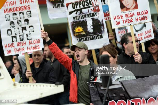 Dissident Republican group Saoradh protest as a Justice for Northern Ireland Veterans rally takes place outside City Hall on April 14 2017 in Belfast...