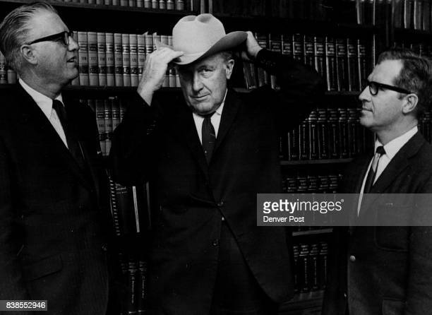 Dist Judge George McNamara center Finally got a hat that he could wear a 75/8ths Chapeau was presented by John Secrest left Stetson region...