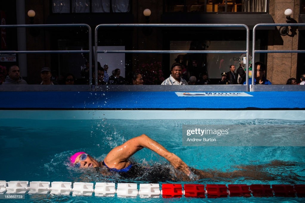 Distance Swimmer Diana Nyad swims in a 40-meter pool, constructed in Herald Square, during an attempt to swim for 48 hours straight to support victims of Hurricane Sandy on October 8, 2013 in New York City. In August 2013 Nyad, age 64, swam non-stop from Florida to Cuba without a shark cage, a distance of approximately 110 miles, in approximately 53 hours. Nyad will swim with partners throughout the 48 hour challenge, and will be visited by various athletes and celebrities, too.