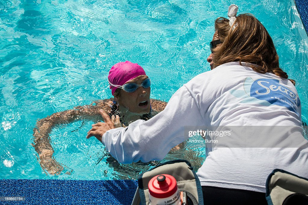 Distance Swimmer Diana Nyad (L) talks to a member of her team during an attempt to swim for 48 hours straight in a constructed 40-meter pool in Herald Square, to support victims of Hurricane Sandy on October 8, 2013 in New York City. In August 2013 Nyad, age 64, swam non-stop from Florida to Cuba without a shark net - a distance of approximately 110 miles, in approximately 53 hours. Nyad will swim with partners throughout the 48 hour challenge, and will be visited by various athletes and celebrities, too.