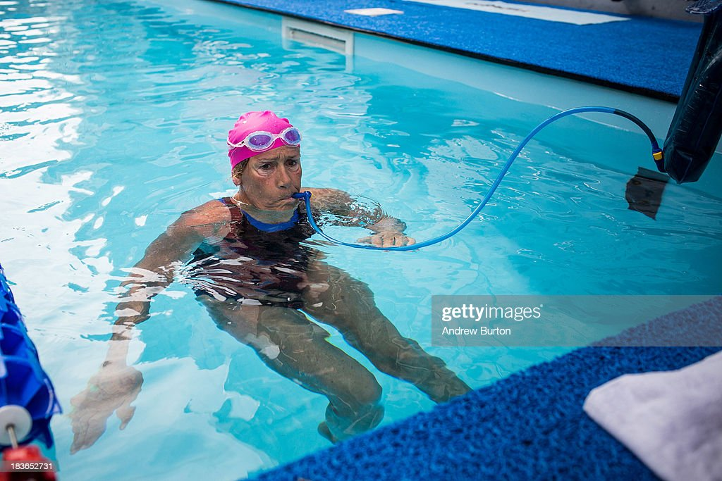 Distance Swimmer Diana Nyad treads water during a snack break during an attempt to swim for 48 hours straight in a constructed 40-meter pool in Herald Square, to support victims of Hurricane Sandy on October 8, 2013 in New York City. In August 2013 Nyad, age 64, swam non-stop from Florida to Cuba without a shark cage, a distance of approximately 110 miles, in approximately 53 hours. Nyad will swim with partners throughout the 48 hour challenge, and will be visited by various athletes and celebrities, too.
