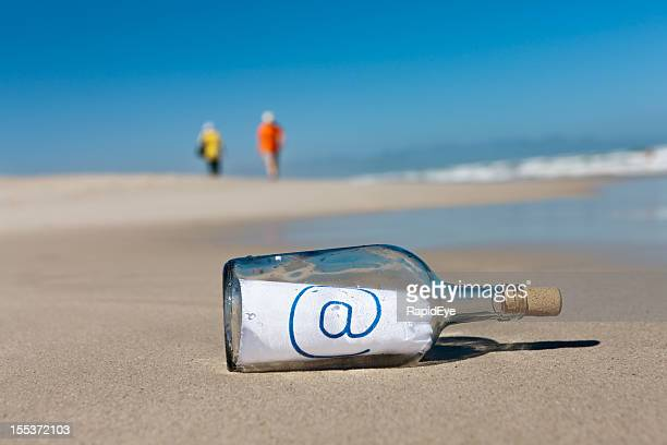 "Distant beachcombers ignore message in bottle saying ""@"""