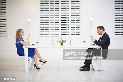 Distant couple having dinner together