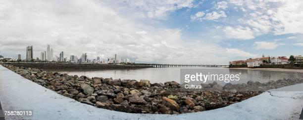 Distant panoramic view of Panama city skyline from waterfront, Panama