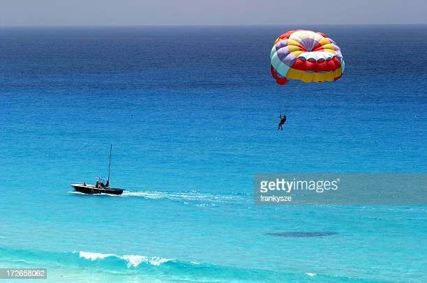 Distant shot of parasailing over ocean