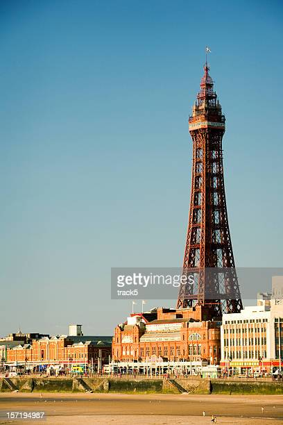 Distant view of Blackpool Tower under clear, blue sky.