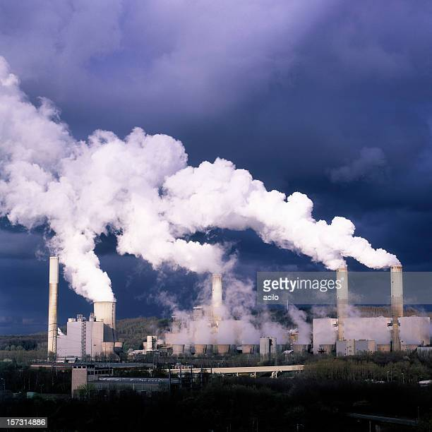 A distant view of smoke billowing from a power plant