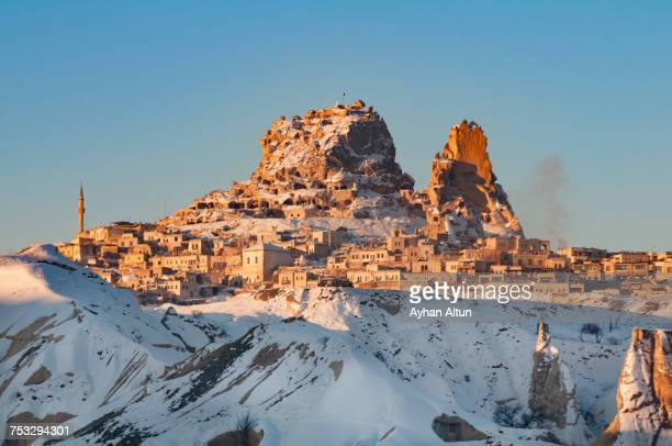 Distant view of The Uchisar castle and town at winter, Cappadocia, Nevsehir, Turkey