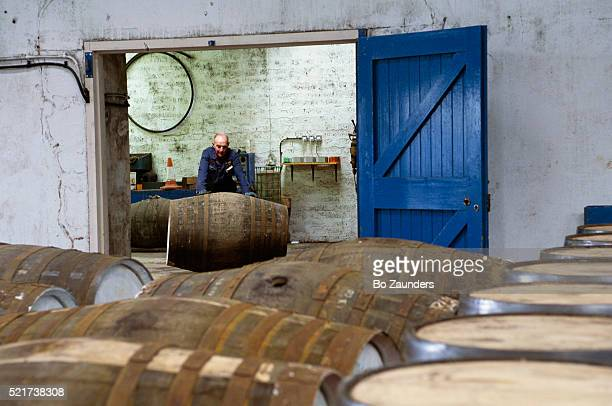Distillery Worker Rolling Out of Barrel
