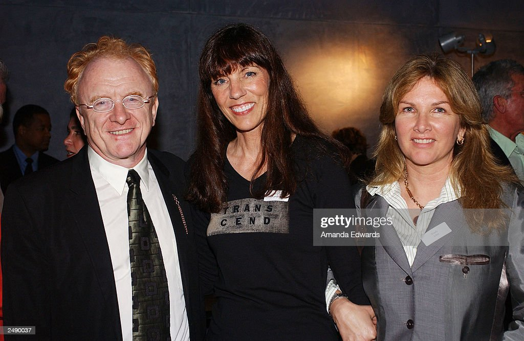 Distinguished guests Peter and Wendy Asher pose with Denise Feathers at the Santa Monica Museum of Art's Party with Frank Gehry at Chuck Arnoldi's art studio on September 12, 2003 in Venice, California.
