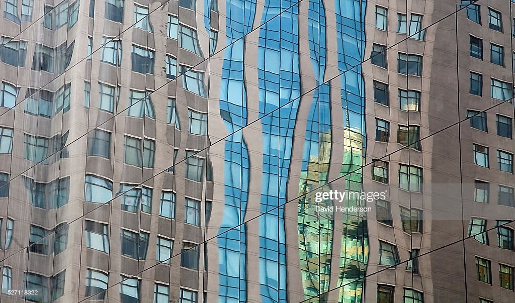 Distorted reflection in a mirrored skyscraper : Stock Photo
