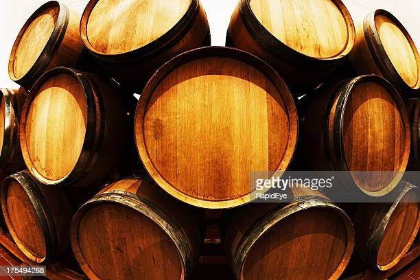 Distorted view of stacked wine barrels in winery