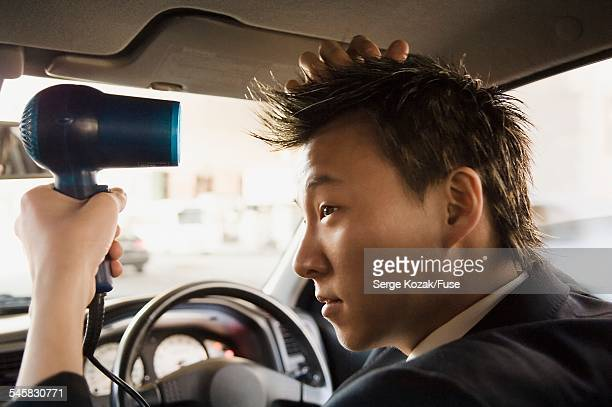 Distracted Businessman Fixing His Hair