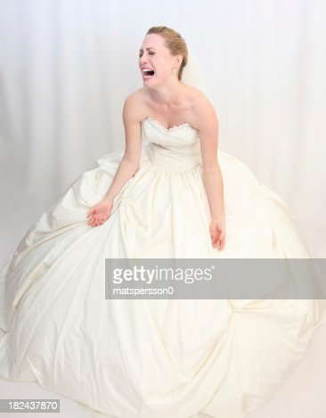 Distraught bride crying with arms outstretched