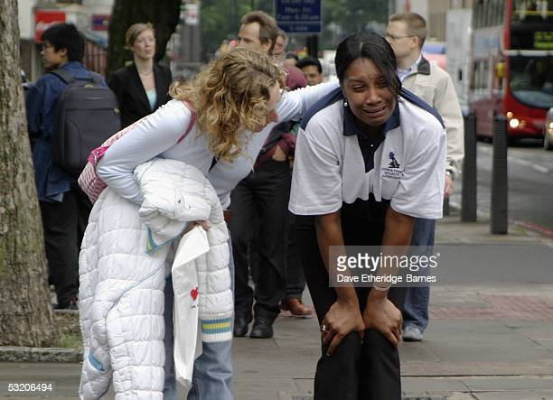 A distraught commuter is consoled near to Euston station after a series of explosions ripped through London's transport network on July 7 2005 in...