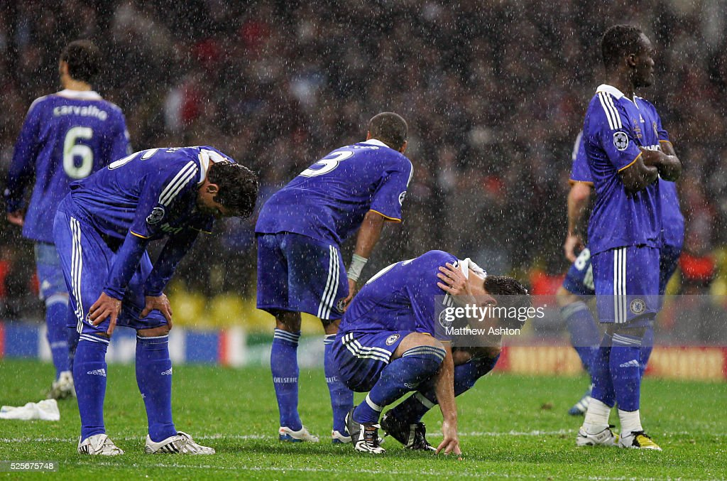 A distraught John Terry of Chelsea hides his face after Chelsea lose the Champions League Final on penalties