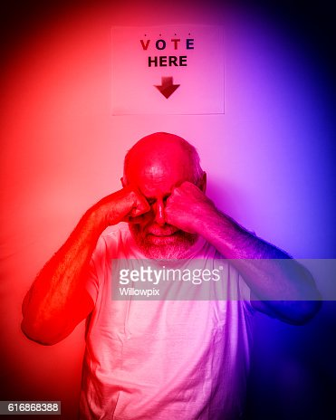 Distraught USA Independent Voter Senior Man Rubbing Eyes Crying : Stock Photo