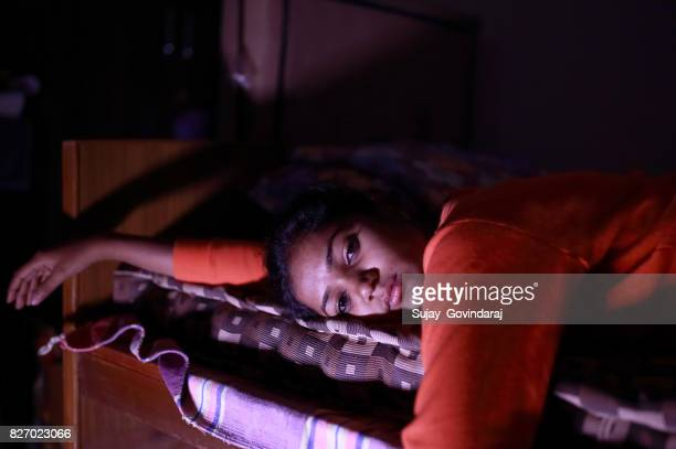 Distressed Female Lying on Bed