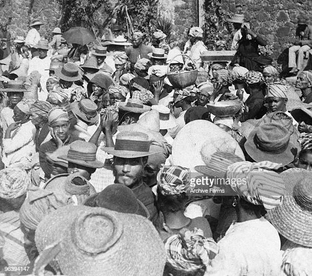Distributing relief supplies to refugees fleeing after the eruption of the Mount Pelee volcano on May 10 1902 at St Pierre Martinique