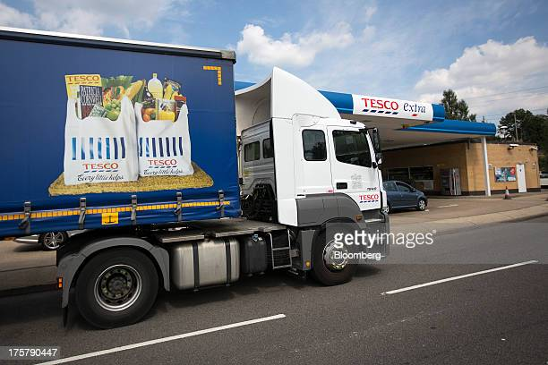 A distribution truck passes a Tesco Extra gas station outside a Tesco Plc store in Watford UK on Thursday Aug 8 2013 UK grocery sales rose sharply as...