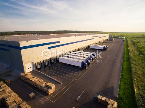 distribution warehouse with trucks of different capacity : Stock Photo