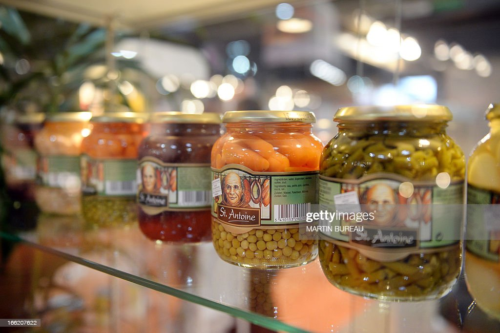 Distributor brand canned vegetables are displayed on April 10, 2013 at the MDD Expo (distributor brands expo) of major supermarket chain brands in Paris. The fair presents food made and sold under the names of major supermarket outlets, such as Casino, Carrefour, Cora, Monoprix or Super U. AFP PHOTO / MARTIN BUREAU