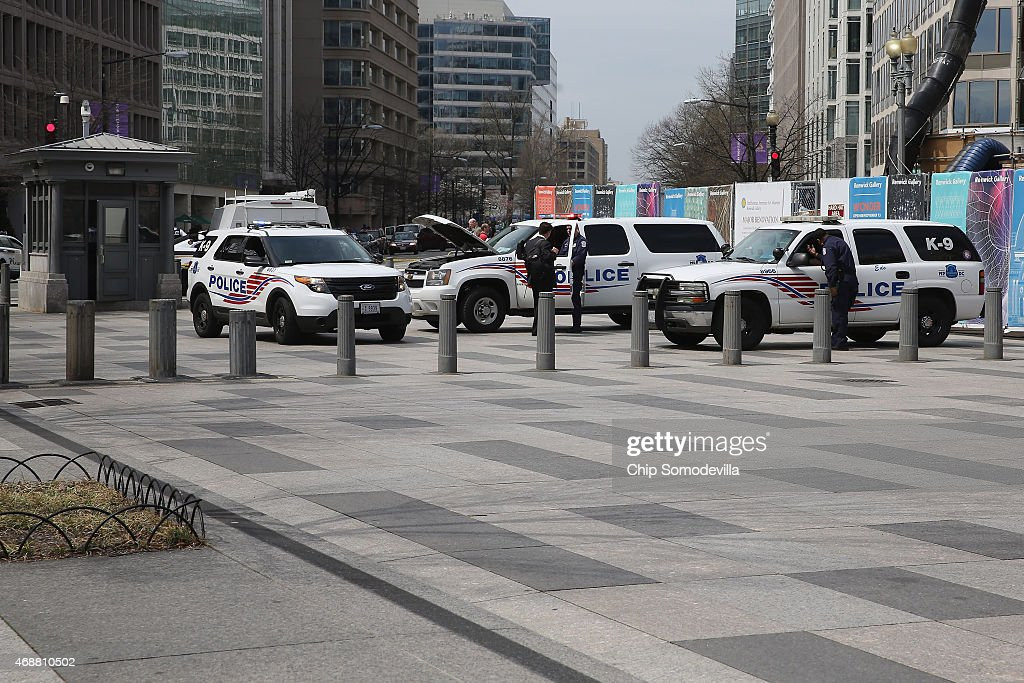 District of Columbia Metro Police vehicles help block Pennsylvania Avenue near the White House after an electrical blackout affected the executive...