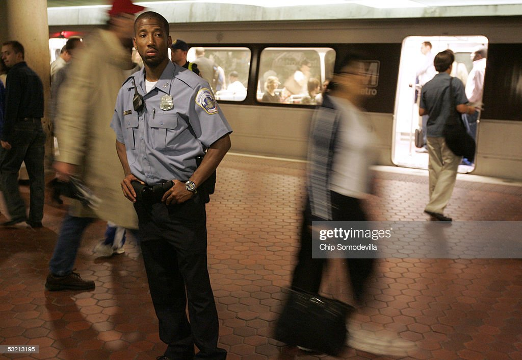 District of Columbia Metropolitan Police Officer D. Charles keeps an eye on the morning rush hour passengers at the Metro Center subway stop July 8, 2005 in downtown Washington, DC. Security on and around the DC Metro subway trains and buses was increased in the wake of explosions that killed at least 50 people and injured hundreds of others on London's mass transit system on July 7th. In the wake of the London attacks, the U.S. Department of Homeland Security raised the threat level to high, or code 'orange,' for mass transportation systems in the United States.