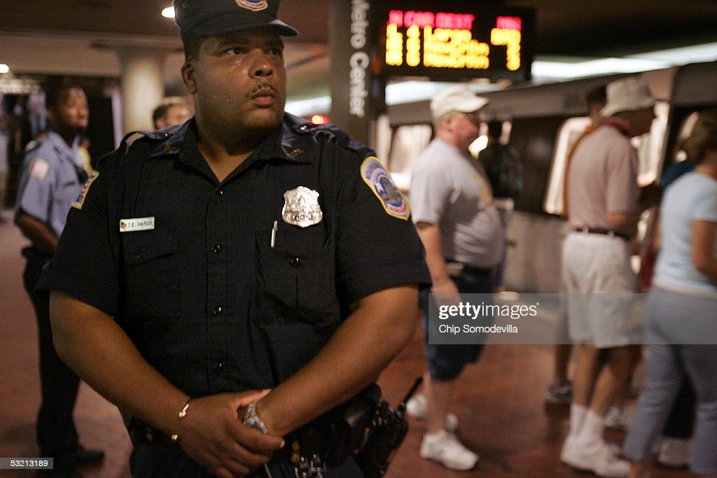 District of Columbia Metropolitan Police Officer T. Hardy keeps an eye on the morning rush hour passengers at the Metro Center subway stop July 8, 2005 in downtown Washington, DC. Security on and around the DC Metro subway trains and buses was increased in the wake of explosions that killed at least 50 people and injured hundreds of others on London's mass transit system on July 7th. In the wake of the London attacks, the U.S. Department of Homeland Security raised the threat level to high, or code 'orange,' for mass transportation systems in the United States.