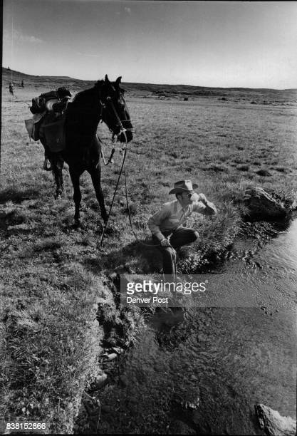 District Ranger Larry Robinson Sips Water From Cup He's just finished watering his horse in the meadows of Flat Tops Credit Denver Post