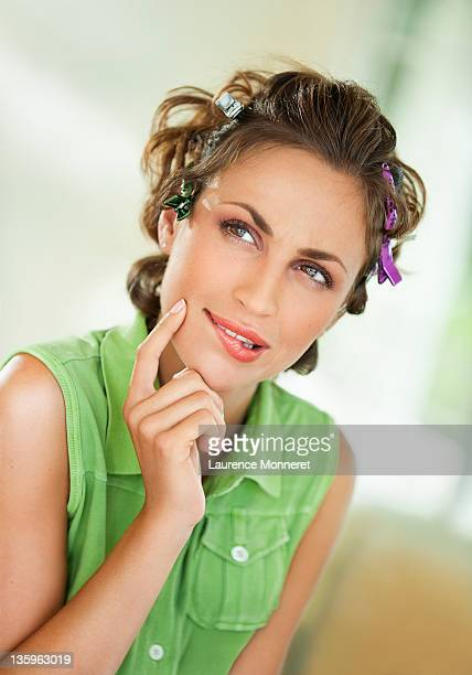 Disturbed woman with hairpins looking on side
