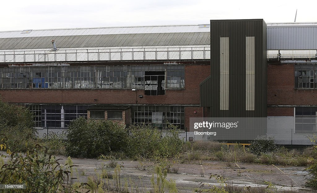 A disused factory building stands on the grounds of the Ford Motor Co. automobile plant in Dagenham, U.K., on Monday, Oct. 29, 2012. Ford Motor Co. will shut three European plants, its first factory closings in the region in a decade, and cut 5,700 jobs to stem losses that the carmaker predicts will total more than $3 billion over two years. Photographer: Simon Dawson/Bloomberg via Getty Images