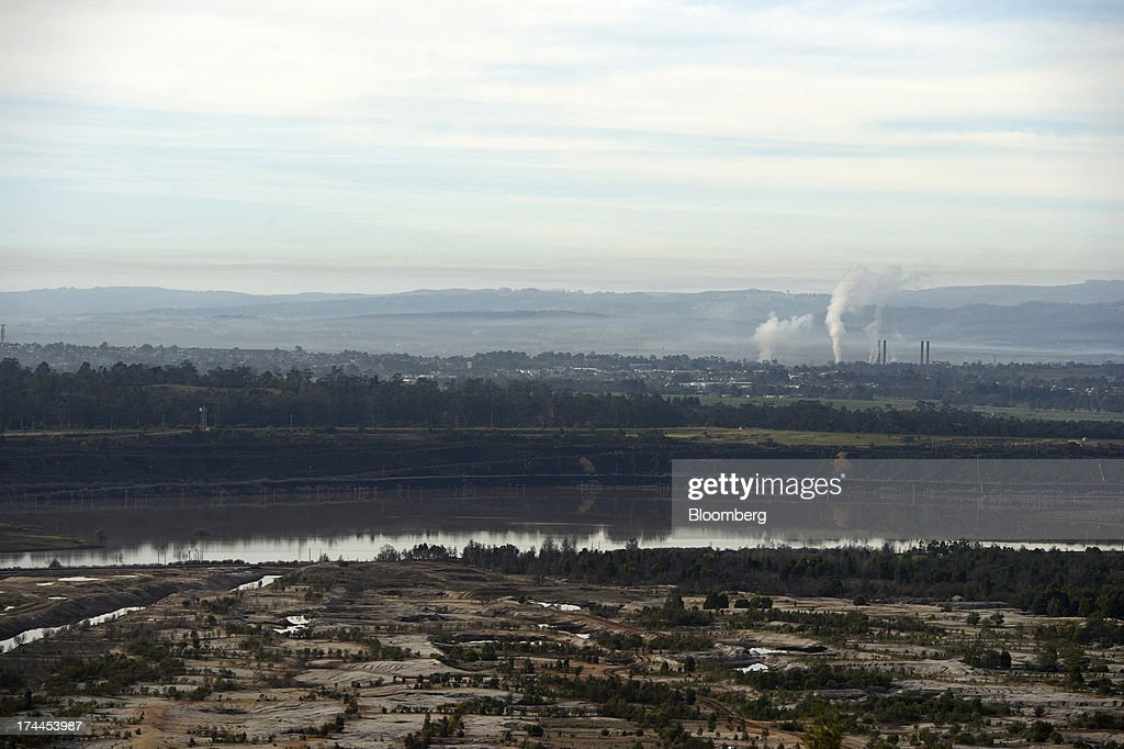 A disused, mined field sits in front of a body of water supplying nearby coal-fired power stations near Morwell, Australia, on Thursday, July 25, 2013. Australian Prime Minister Kevin Rudd will cut spending and limit tax concessions to fund a move to emissions trading a year ahead of schedule, should his Labor government win this year's election. Photographer: Carla Gottgens/Bloomberg via Getty Images