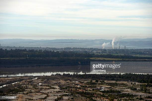 A disused mined field sits in front of a body of water supplying nearby coalfired power stations near Morwell Australia on Thursday July 25 2013...